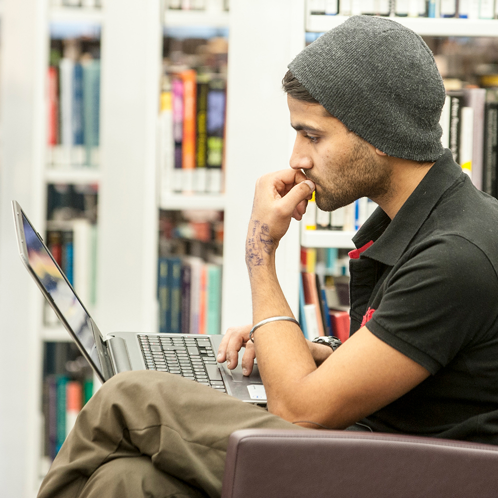 Bachelor of Arts student studying in the library