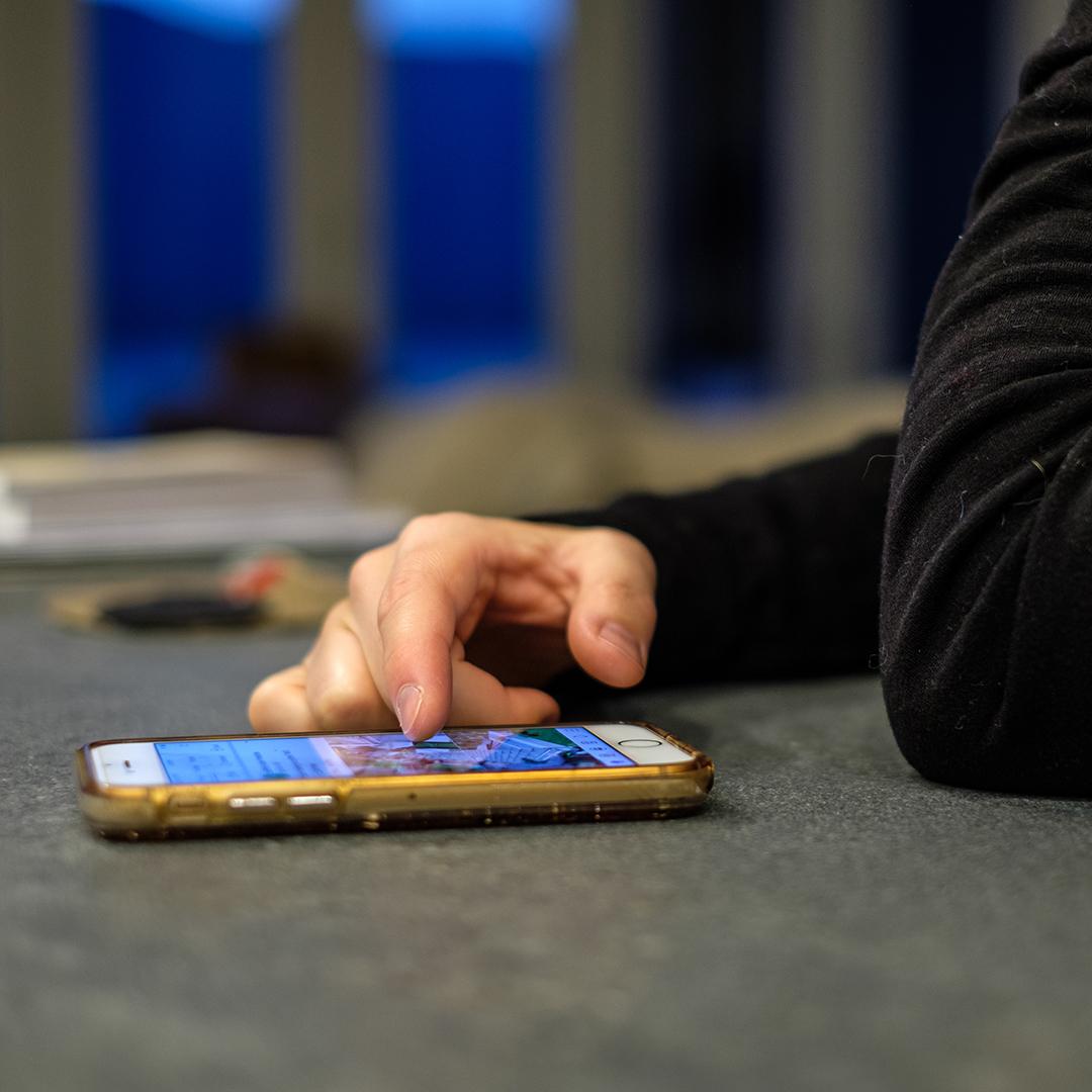 Man looking at social media on a phone